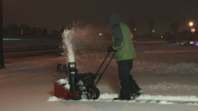 Teenager snow blowing back angle 1080p 4K UHD stock footage