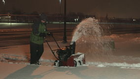 Teenager snow blowing 4K UHD stock video