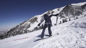 Teenager snowboarder woman jumps at kicker stock footage