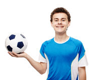 Teenager soccer player holding the ball Royalty Free Stock Photo