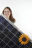 Teenager with solar panel Stock Images