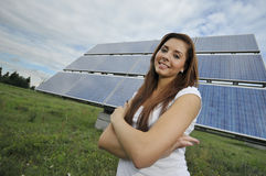 Teenager with solar panels Stock Photo