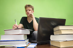 Teenager solving a problem Stock Photo