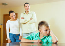 Teenager son and parents after quarrel. Focus on boy only Stock Image