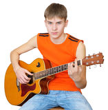 A teenager with a Spanish guitar Royalty Free Stock Photo