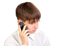 Teenager speak phone. The teenager speaking by mobile phone stock image