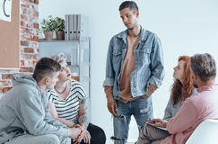 Teenager speaking to a group. Of contemporaries on therapy session Stock Photos