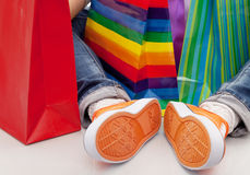 Purchases. Teenager Sport shoes  with shopping bags Royalty Free Stock Photos