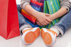 Purchases. Teenager Sport shoes  with shopping bags Royalty Free Stock Photography