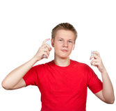 Teenager spraying fragrance perfume. Portrait on a white background Royalty Free Stock Photos
