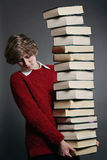 Teenager with stack of books Royalty Free Stock Photo