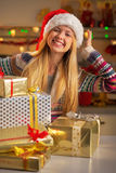 Teenager with stack of christmas present boxes Stock Images