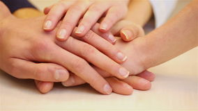 Teenager stacking hands for. Teenager stacking hands as a symbol for teamwork (Full HD stock footage