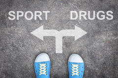 Teenager Standing At The Crossroad - Sport Or Drugs Stock Photos