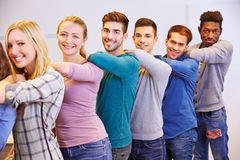Teenager standing behind each other in school Stock Images