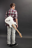 Teenager standing with electric guitar Royalty Free Stock Photos