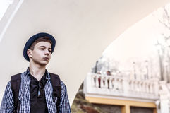 Teenager standing facing the white wall Stock Image