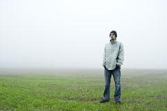 Teenager standing in field Stock Photography