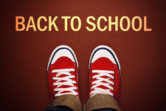 Teenager Standing in Front of Back To School Line Royalty Free Stock Photo