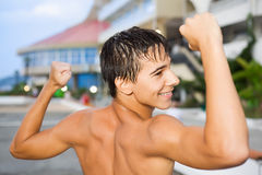 Teenager standing near hotel on resort in evening Royalty Free Stock Photo