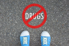 Teenager standing at NO DRUGS ZONE Royalty Free Stock Images