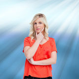 Teenager standing upright thoughtfully with her fingers on her chin Royalty Free Stock Photos