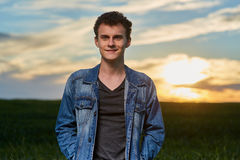 Teenager standing in a wheat field at sunset Royalty Free Stock Photo