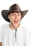 Teenager in stetson hat. Portrait of cheerful teenager in the stetson hat. isolated on the white background Royalty Free Stock Photo