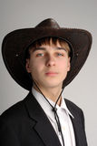 Teenager in stetson hat. Teenager portrait in the studio in the stetson hat Royalty Free Stock Image