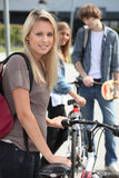 Teenager stood by bicycle Royalty Free Stock Photography
