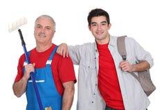 Teenager stood with decorator Stock Photo