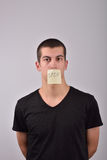 Teenager with stop note on the mouth Royalty Free Stock Photography