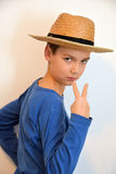 Teenager with straw hat. Portrait of a teenager boy with straw hat royalty free stock image