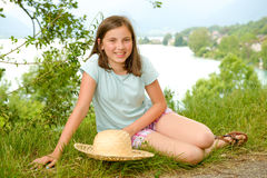 Teenager with a straw hat in the wild. A teenager with a straw hat in the wild Stock Images