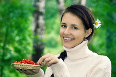 Teenager with  strawberries Stock Photo