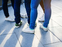 Teenager street wear Jeans pant and sneakers Stock Image