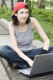 Teenager/Student With Laptop. Teenager/Student In A Park With Laptop Stock Photography