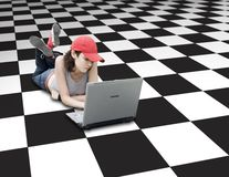 Teenager/Student With Laptop. On Checker Background Royalty Free Stock Photo