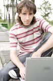 Teenager/Student With Laptop. Teenager/Student In A Park With Laptop Royalty Free Stock Photo