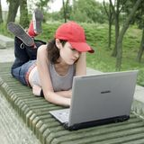Teenager/Student With Laptop. Teenager/Student In A Park With Laptop Stock Image
