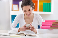 Teenager student typing message Royalty Free Stock Photography