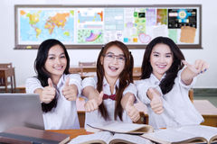 Teenager students shows thumbs up in class Stock Photo