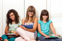 Teenager students sitting with files. Stock Image