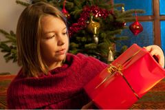 Teenager  studying christmas gift Royalty Free Stock Image