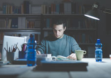 Teenager studying late at night Royalty Free Stock Images