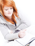 Teenager studying and making some notes Stock Photo