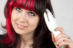Teenager styling hair Stock Photo