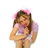Teenager with sugarplum Royalty Free Stock Image
