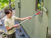 Teenager Summer Job Painting the House stock images