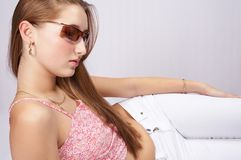 Teenager with sunglasses. Nice teenager with long hair and sunglasses Royalty Free Stock Images